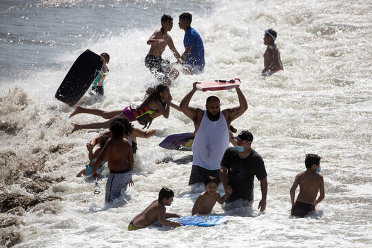 People play in the water on the record heat wave