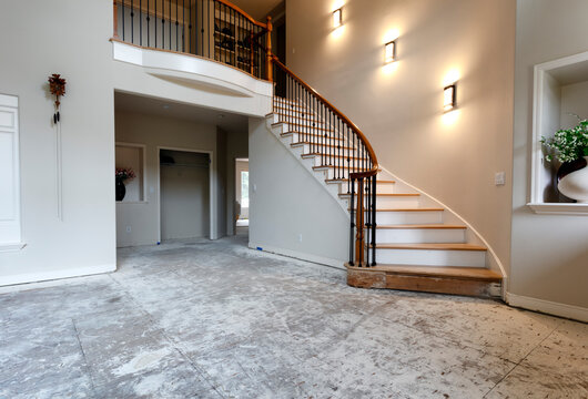Staircase lights and floor being remodeled with red oak wood