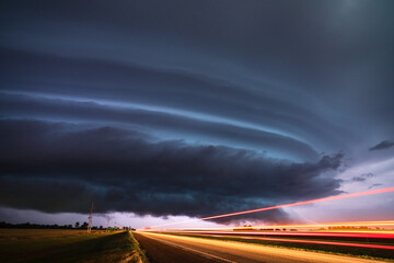 Supercell thunderstorm with dramatic storm clouds during a severe weather outbreak in Kansas.