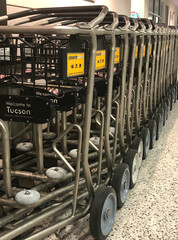Luggage carts stacked together, unused in an empty Tucson International Airport in Arizona