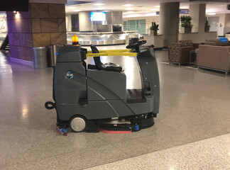 Automated floor cleaning machine at an empty Tucson International Airport in Arizona