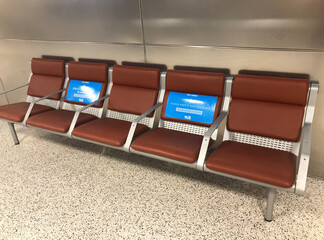 Seating with social distancing signs attached at Tucson International Airport in Arizona