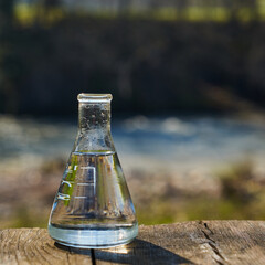 Glass flask with clean drinking water.