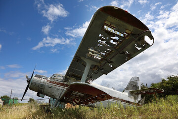 Old crashed and abandoned small propeller plane. Airplane graveyard