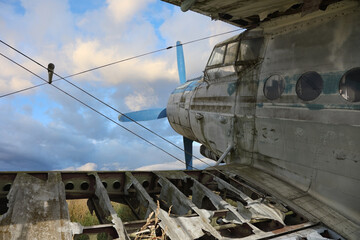 An old abandoned propeller plane stands moored forever