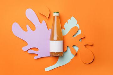 Bottle of juice on color background