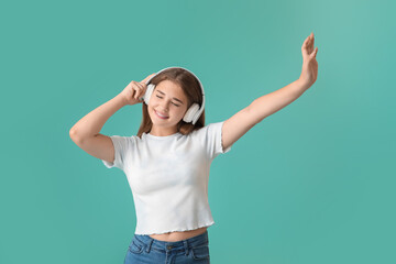 Teenage girl listening to music on color background