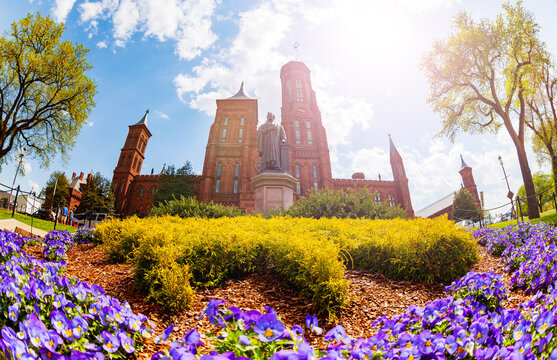 Professor Joseph Henry Statue and Smithsonian Castle on national mall in Washington D.C.