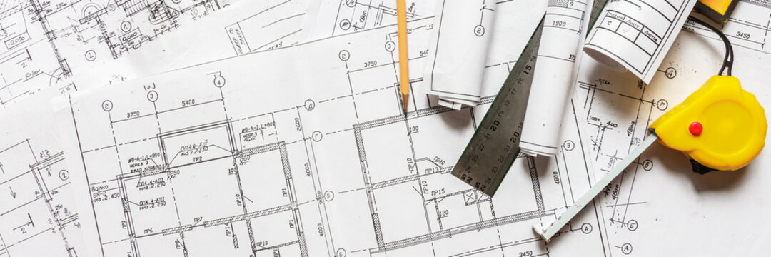 architect design working drawing sketch plans blueprints and making architectural construction model in architect studio,flat lay.