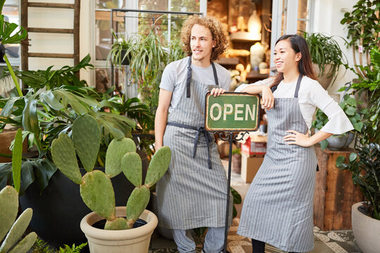 Florists with sign Open open flower shop
