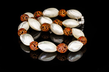 White shells necklace on a black background