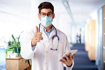 Portrait shot of male doctor giving thumbs up