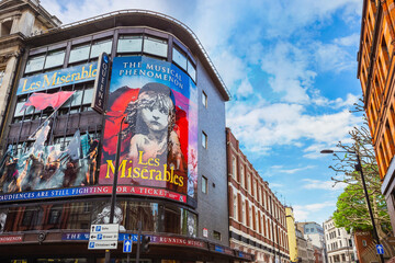 London, United Kingdom - May 13 2018: Queen's Theatre  in Shaftesbury Ave. on the corner of Wardour St. opened on 8 October 1907 as a twin to the neighbouring Hicks Theatre (now Gielgud Theatre)