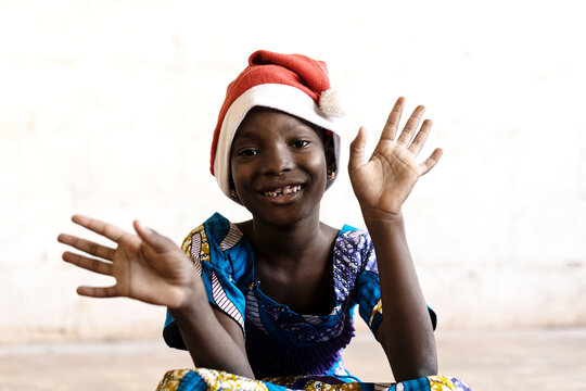 Gorgeous African Schoolgirl posing for Christmas with Hat and Hands Open