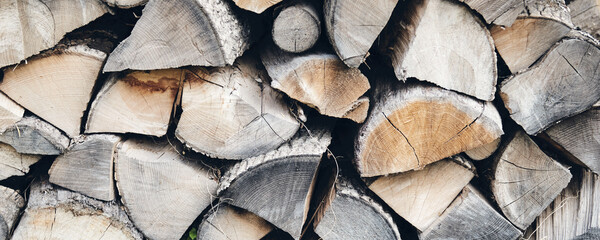 Logs in a sawmill yard. Stacks of woodpile firewood texture background