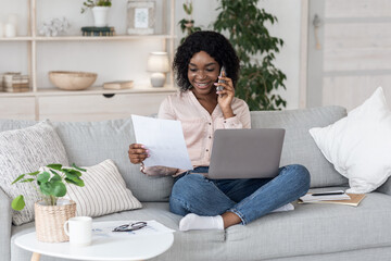 Self-Employment. Busy Woman Working At Home With Laptop, Mobile Phone And Documents