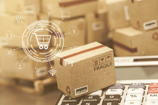 business concept: Small cardboard boxes and calculator. Concept of Increasing product rates the expansion of export business to plan marketing or finance go future. which expected return is maximized.