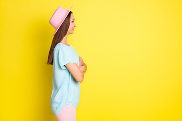 Profile side photo of confident charming pretty girl cross hands look copyspace listen summer travel trip guide wear casual style clothes isolated over vivid color background