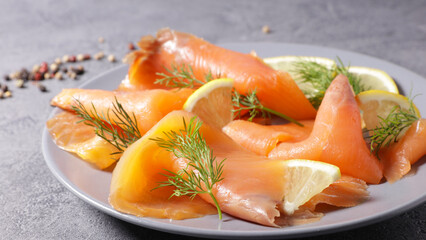 smoked salmon with dill and lemon on plate