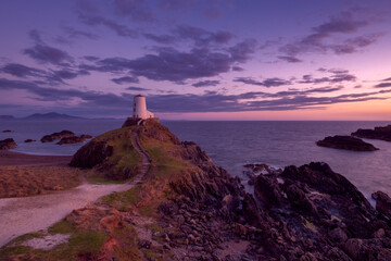 Photo sur Toile Cote llanddwyn lighthouse anglesey north wales uk at sunset