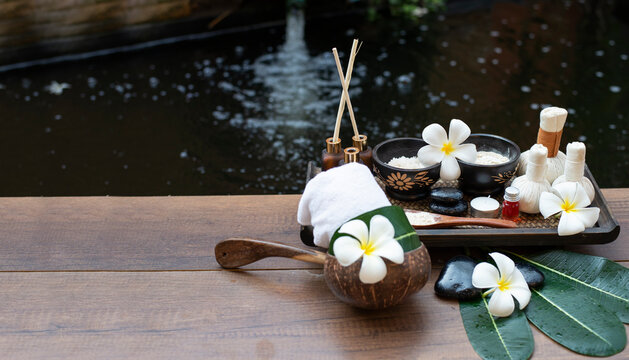 Spa massage compress balls, herbal ball on the wooden with treaments spa