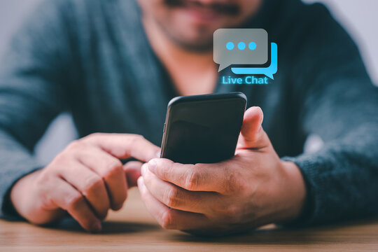 Live chat technology concept, man hand pressing virtual screen on smartphone.