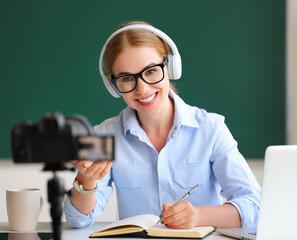 Foto auf Leinwand Vogel auf Asten Delighted teacher recording online lesson.