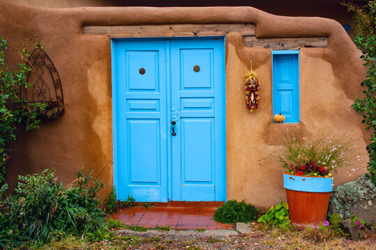 Blue door of Adobe House in New Mexico Southwest USA