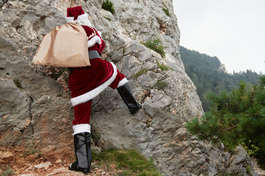 santa claus overcoming obstacles with the bag of gifts