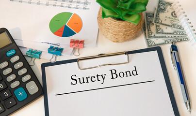 Concept image for blog headline or header image. Surety Bond inscription on paper.