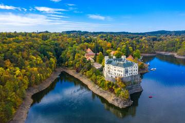Aerial view chateau Orlik, above Orlik reservoir in beautiful autumn nature. Romantic royal...