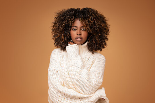 Afro girl in cozy fashionable sweater.