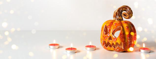 Pumpkin lantern jack and burning candles. Halloween banner