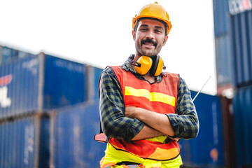 Professional engineer container cargo foreman in helmets working standing and using walkie talkie checking stock into container for loading.logistic and business export