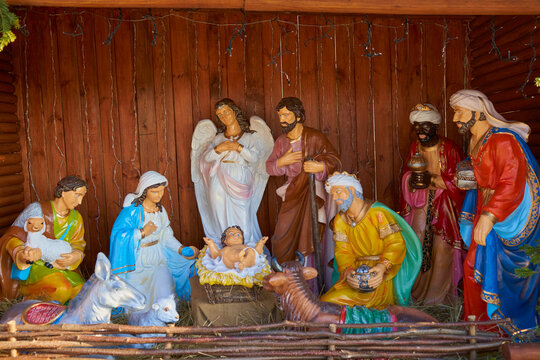 Christmas nativity scene,Christmas statues of the nativity scene Jesus in the hay, Mary with Joseph and kings and an angel and a shepherd with a sheep and a cow