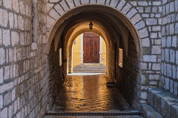 Fototapeta Stone gate under the cathedral tower in the old town of Krk on the island of Krk in Croatia
