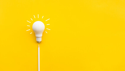 Business creativity and inspiration concepts with lightbulb and pencil on yellow background Papier Peint