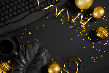 Christmas decorations, ribbons and Christmas balls on a black office table. plans and goals for 2021