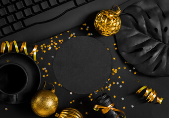 Christmas, New Year black stylish background and frame with a branch of fir and a gift. Copy space. Top view