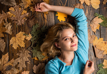 girl relax on autumn background. Beauty in autumn style. Sharing love to nature. Staying beautiful...