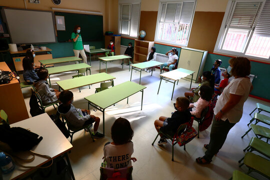 Pupils wearing face masks practice social distancing as they sit in their classroom on the first day of school amid the coronavirus disease (COVID 19) outbreak in Madrid