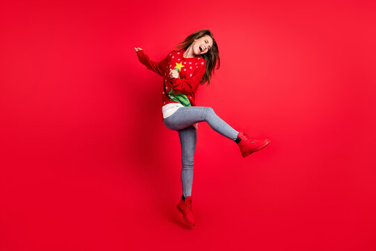 Full length body size view of her nice attractive pretty slim fit overjoyed glad cheerful cheery girl jumping having fun dancing festive mood isolated bright vivid shine vibrant red color background