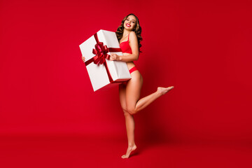 Full length body size view of her she nice attractive lovely stunning cheerful cheery glad wavy-haired girl holding in hands giant giftbox isolated on bright vivid shine vibrant red color background Papier Peint