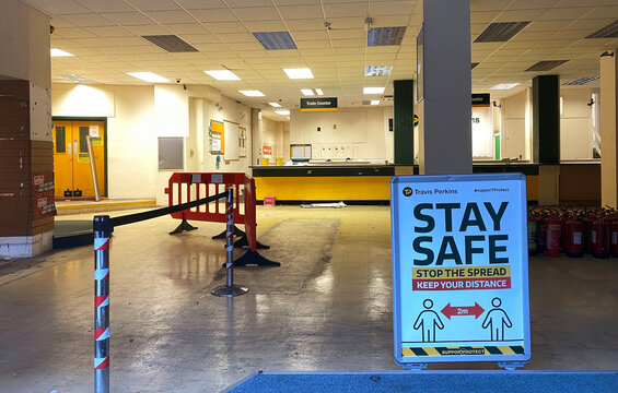 A sign is seen inside an empty branch of Travis Perkins that was closed down in London