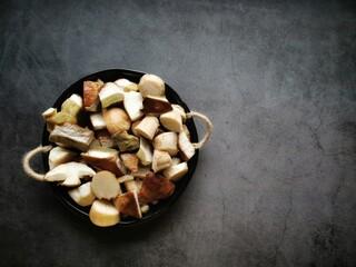 Sliced Penny Bun (Boletus edulis) mushrooms prepared for cooking. Close up. Top view.
