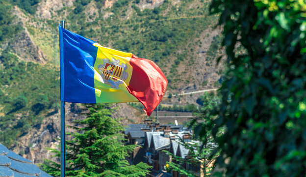 Andorran flag waving in a countryside scenery