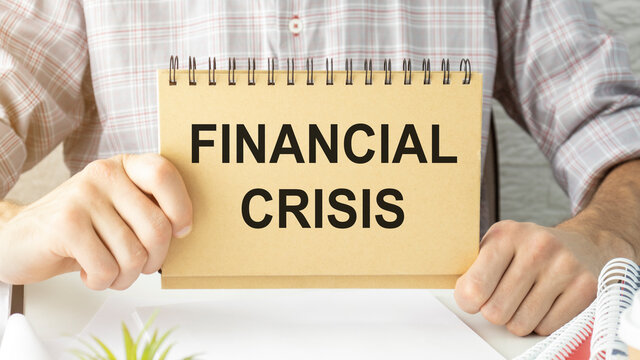 Financial crisis word written on a piece of paper.