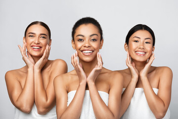 Three Women Touching Face Caring For Skin On Gray Background