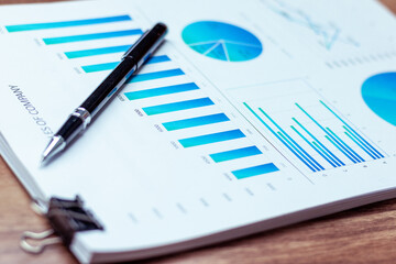Charts and graphs are placed on the desks, data, and statistical performance of the company in the past year.