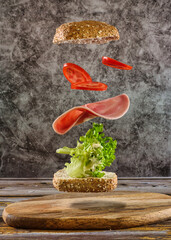 flying food - delicious healthy breakfast bread with a flying topping like ham, tomato and salad